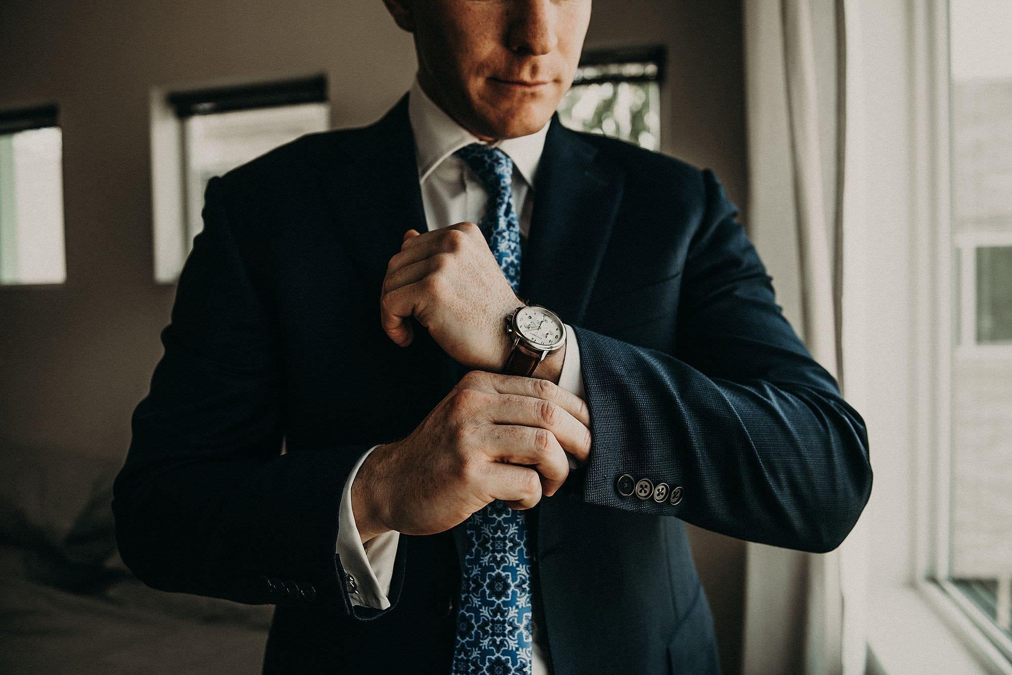 groom dressing for wedding