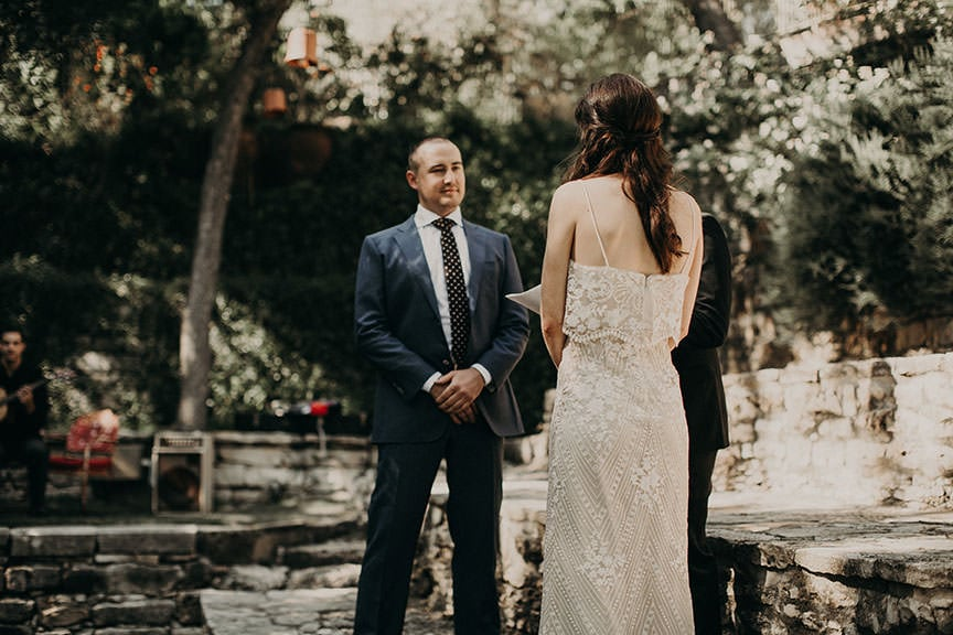 bride and groom at the altar with the officiant of their outdoor wedding in Austin, Texas