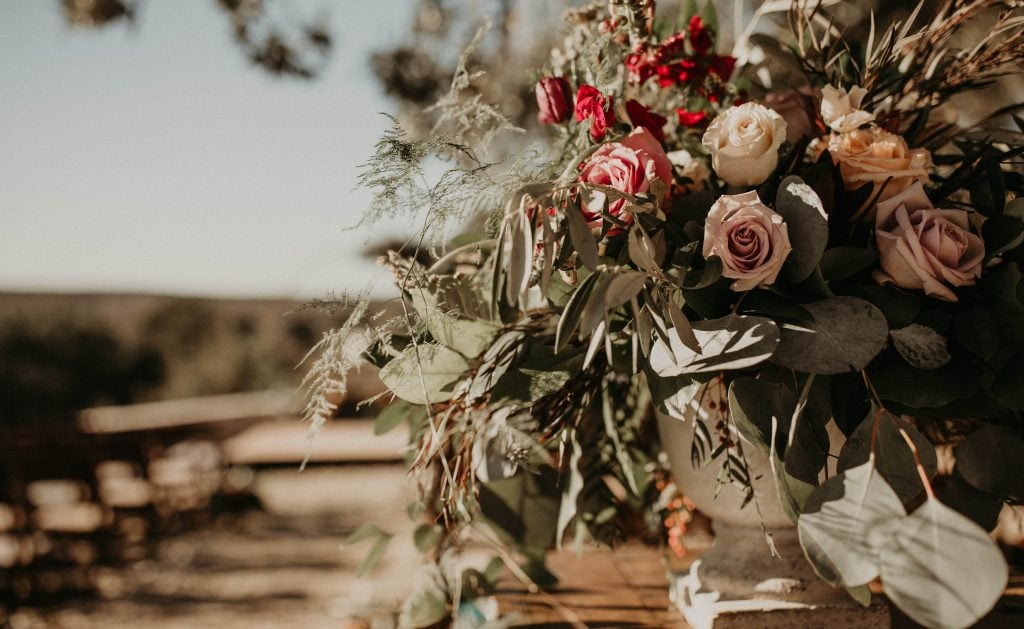 Close up of floral arrangement for ceremony at Villa at Manzuelo Vineyards in Austin, Texas. Photograph by Austin, Texas wedding photographer Nikk Nguyen.