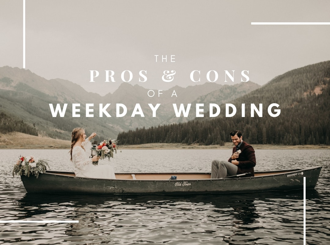 bride holds her bouquet as she sits across from the groom in a canoe on Piney Lake with a mountain range backdrop at Piney River Ranch in Vail, Colorado