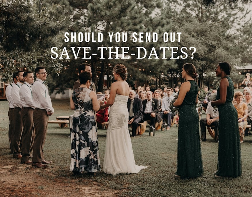 Bride and groom at the altar with the officiant surrounded by their wedding party and with wedding guests sitting in wooden chairs on the lawn behind them at The Homestead in Paige, Texas. Photograph by Austin, Texas wedding photographer Nikk Nguyen.
