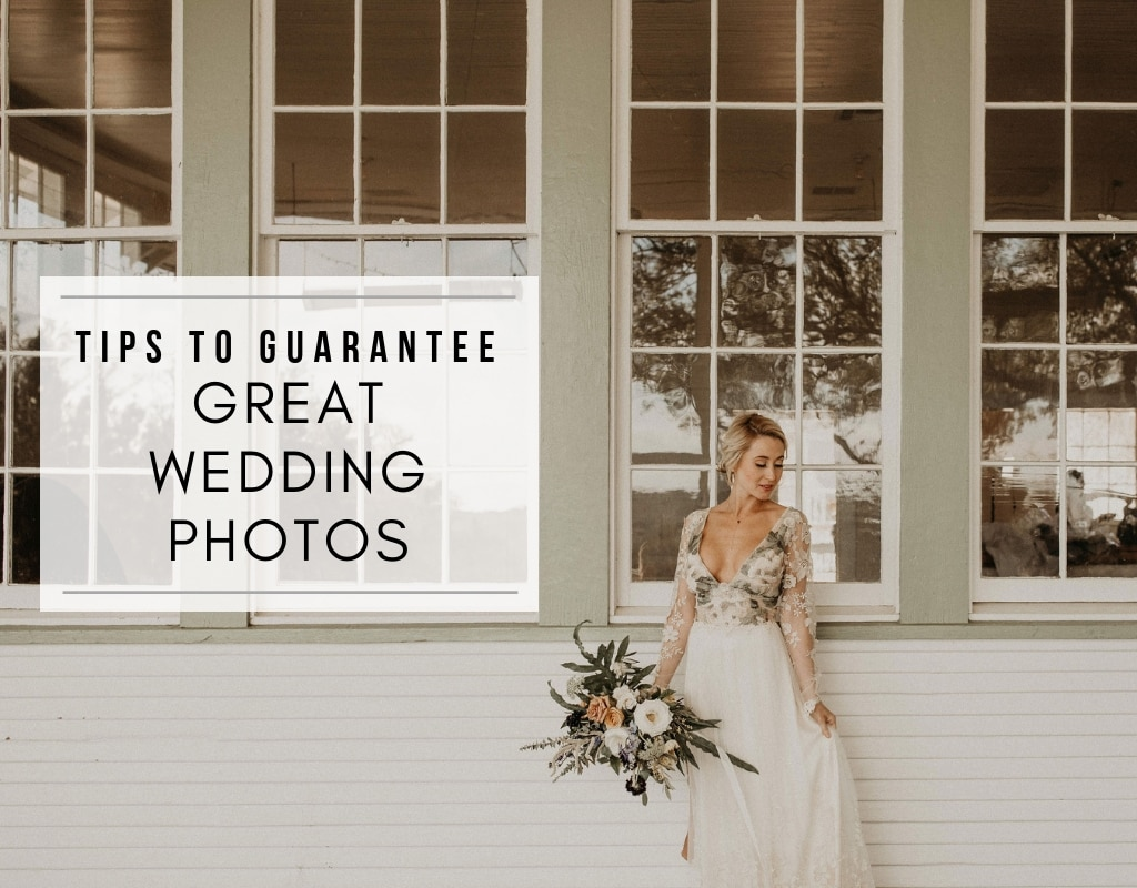 bride stands in front of large glass windows hold a bridal bouquet at her side while looking off to one side