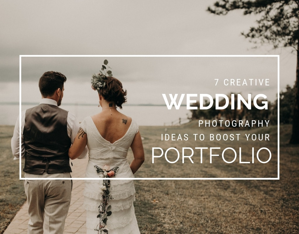 Newly wed bride and groom walk way from the camera down a side walk towards a lake while looking at each other