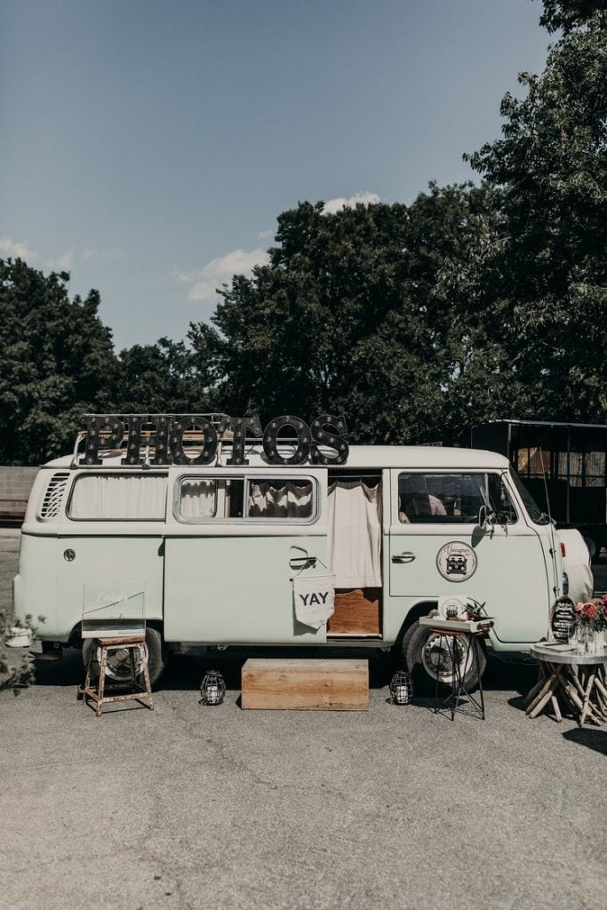 Vintage Volkswagen VW bus as a wedding photo booth. Photograph by Austin, Texas wedding photographer Nikk Nguyen.