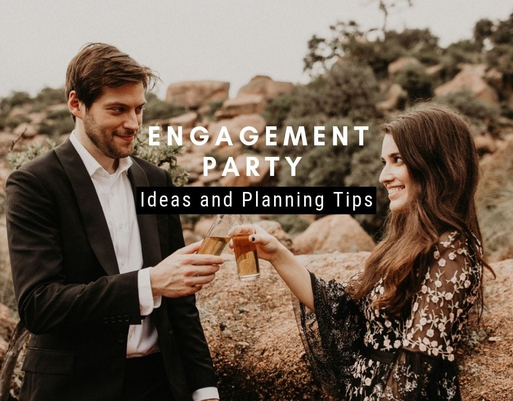 A man in a jacket and button up shirt toasts champaign with a woman in a dress as they stand outside at Enchanted Rock in Fredericksburg, Texas. Photograph by Austin, Texas wedding photographer Nikk Nguyen.