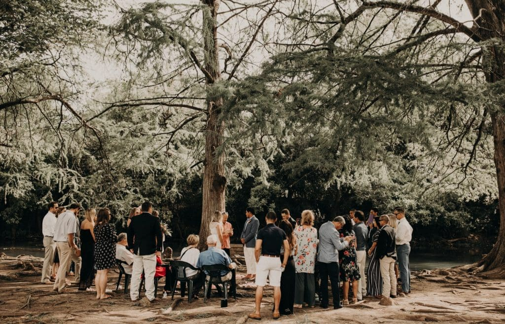 A photo of a group of people attending an outdoor wedding in Austin, Texas. Photograph by Austin, Texas wedding photographer Nikk Nguyen.