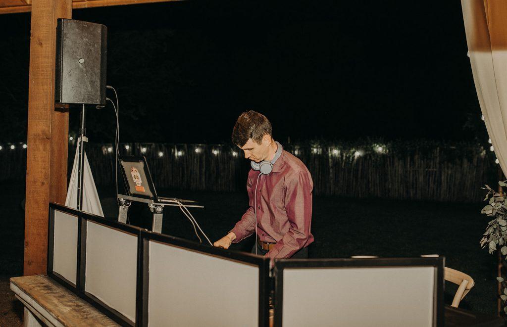 Photo of a DJ at a wedding by Austin, Texas wedding photographer Nikkolas Nguyen.