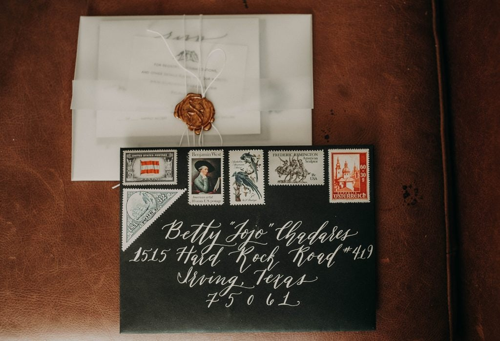 Photo by Austin, Texas wedding photographer Nikkolas Nguyen of an envelope and letter in beautiful calligraphy