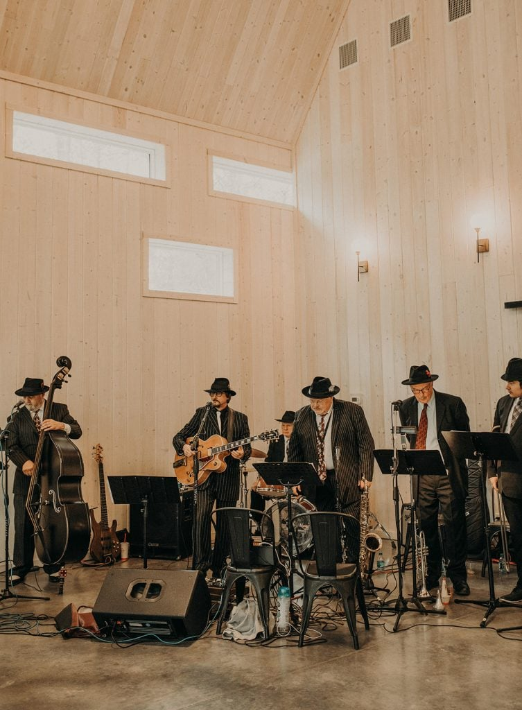 Photo of a live band at a wedding at Dove Hollow Estate by Austin, Texas wedding photographer Nikkolas Nguyen.