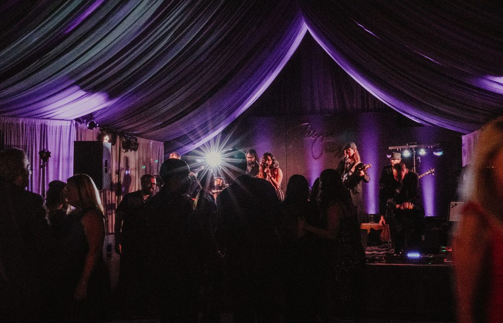 Photo of a live band playing at a wedding venue by Austin, Texas wedding photographer Nikkolas Nguyen.