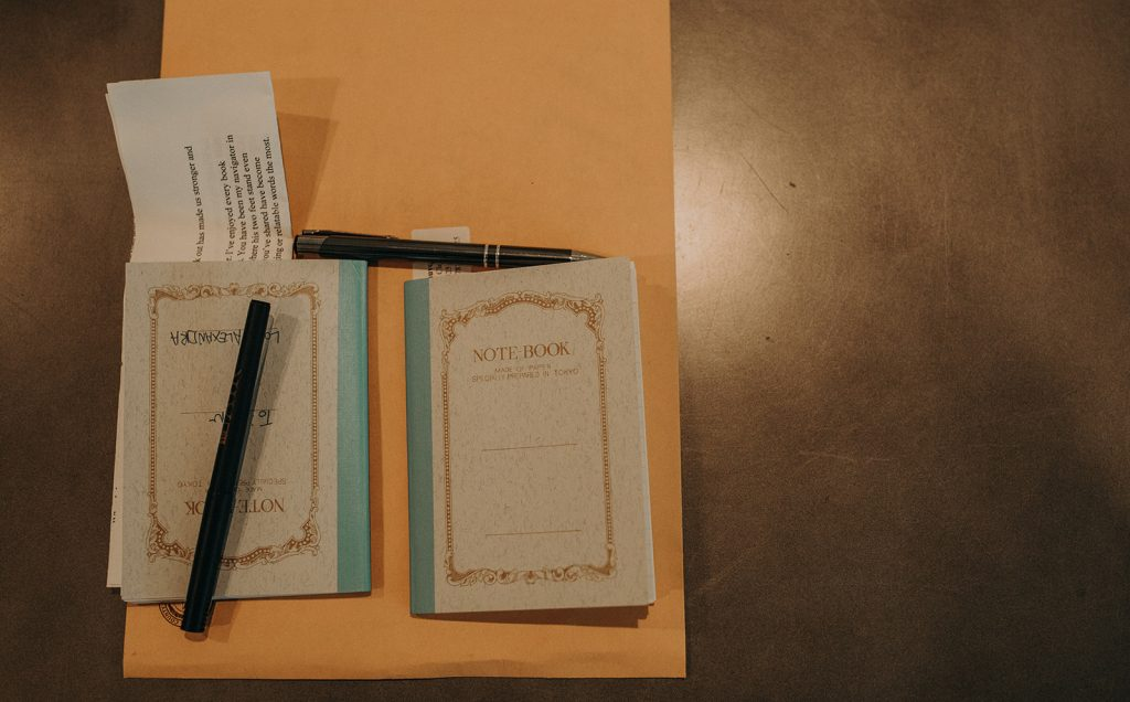Photo by Austin, Texas wedding photographer Nikkolas Nguyen of notebooks and documents used in planning an Austin, Texas wedding