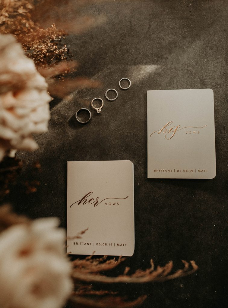 Photo by Austin, Texas wedding photographer Nikkolas Nguyen of wedding stationary of their vows, and the engagement ring and wedding bands