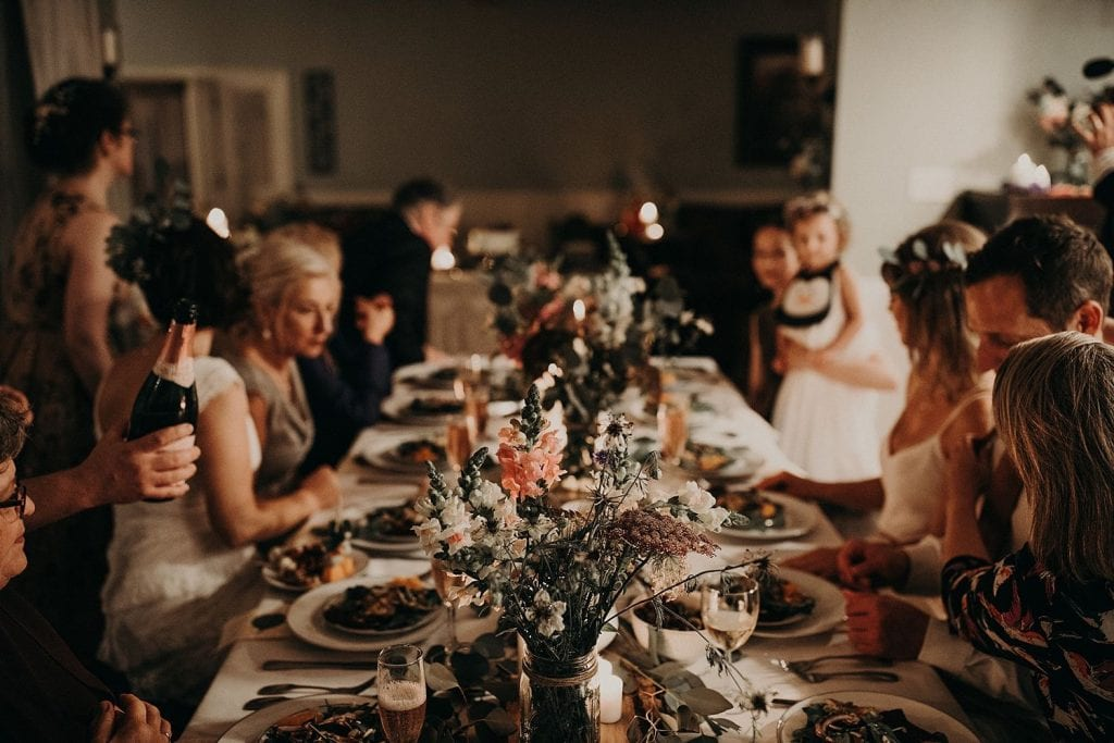 Photo by Nikkolas Nguyen, Austin, Texas Wedding Photographer of table with food and wedding guests enjoying it