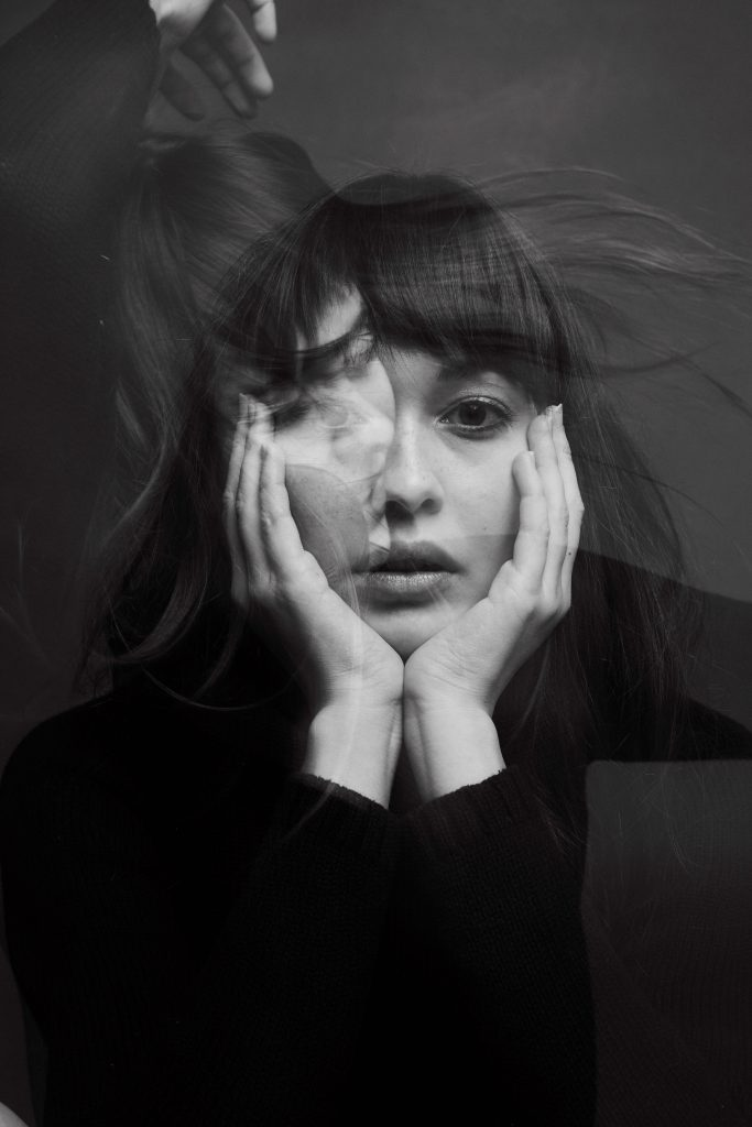 Photo by Fernando Paz, black and white portrait with double exposure