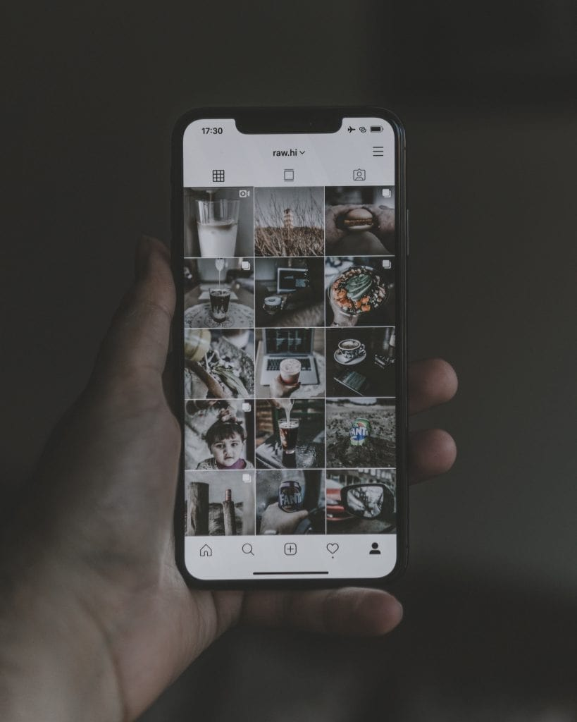Photo of an iPhone showing a carefully curated photographer's Instagram feed