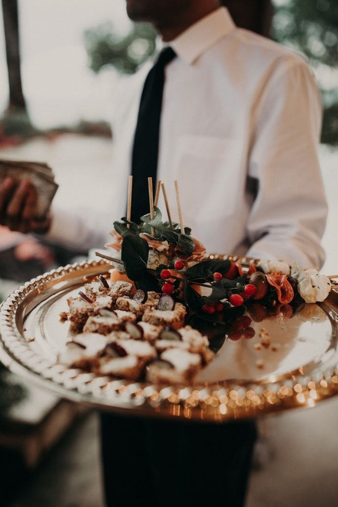 Photo by Nikkolas Nguyen, Austin, Texas Wedding Photographer of caterer holding a serving platter with finger foods