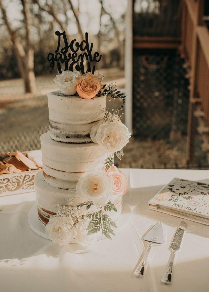 Wedding cake with calligraphy cake topper, Photographed by Austin, Texas wedding photographer NIkk Nguyen