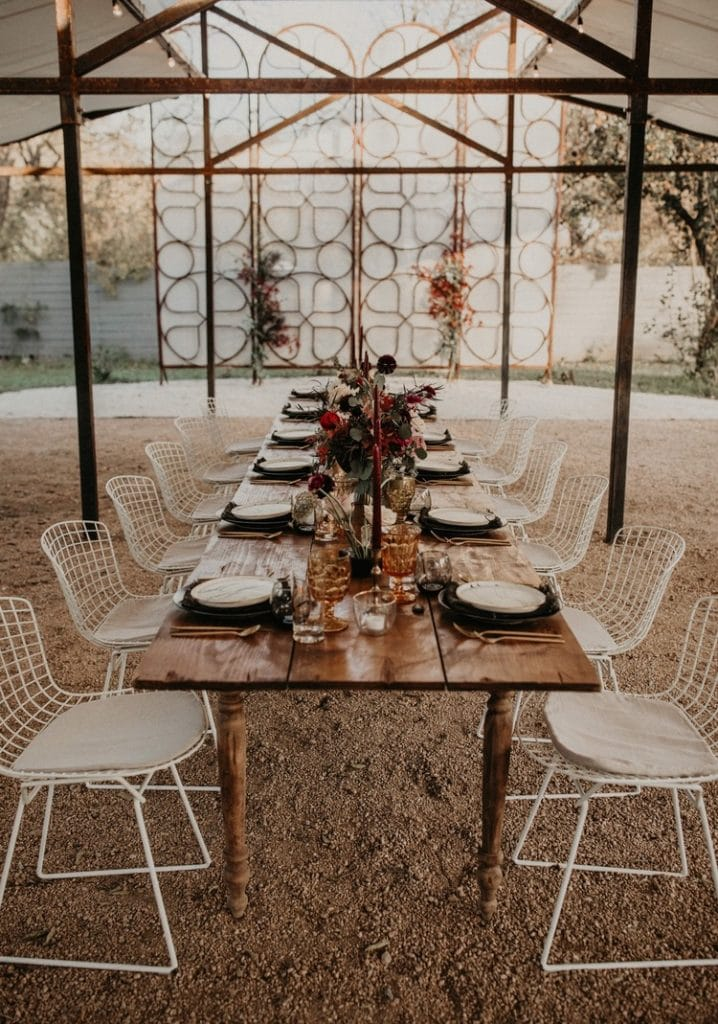 A wedding dinner table set outside, Photographed by Austin, Texas wedding photographer NIkk Nguyen