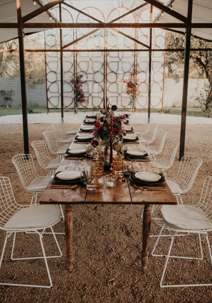 A wedding dinner table set outside, Photographed by Austin, Texas wedding photographer NIkk Nguyen