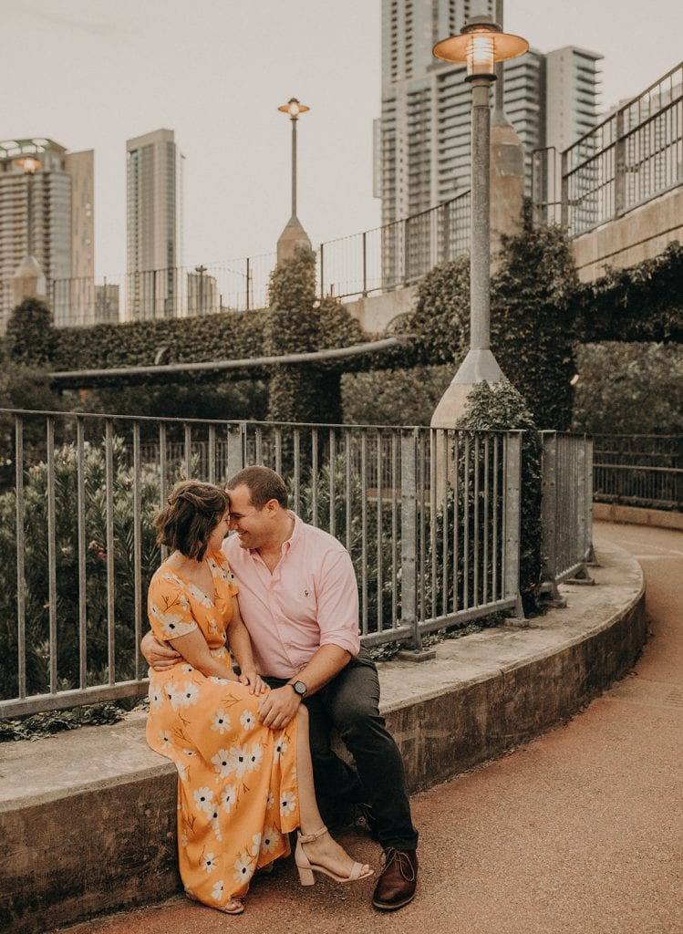 Photo of an engaged couple in downtown Austin, photographed by Austin, Texas wedding photographer Nikk Nguyen