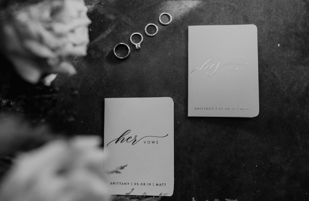 Two notebooks with wedding vows, photographed by Austin, Texas wedding photographer NIkk Nguyen