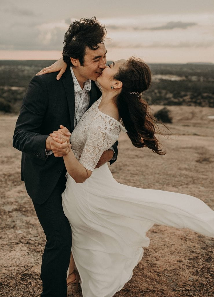 A bride and groom on top of a mountain, Photographed by Austin, Texas wedding photographer NIkk Nguyen