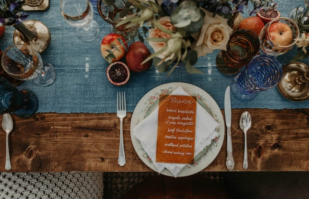 Tablescape of a wedding dinner with a calligraphy menu photographed by Austin, Texas wedding photographer NIkk Nguyen