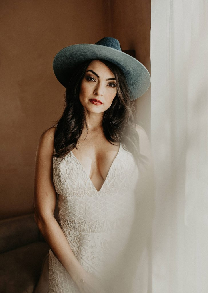 Portrait of a bride with a classic wedding makeup look and bohemian hat style hair, Photographed by Austin, Texas wedding photographer NIkk Nguyen