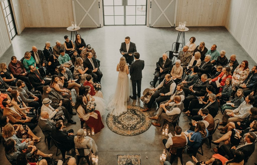 Photo of a wedding ceremony from a birds eye view, photographed by Austin, Texas wedding photographer Nikk Nguyen