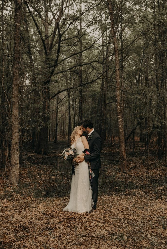 Photo of a bride and groom in a forest, photographed by Austin, Texas wedding photographer Nikk Nguyen