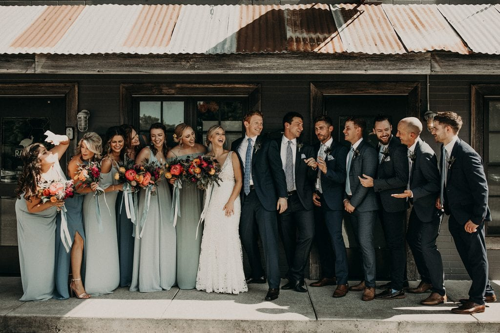Photo of a bridal party laughing together, photographed by Austin, Texas wedding photographer NIkk Nguyen