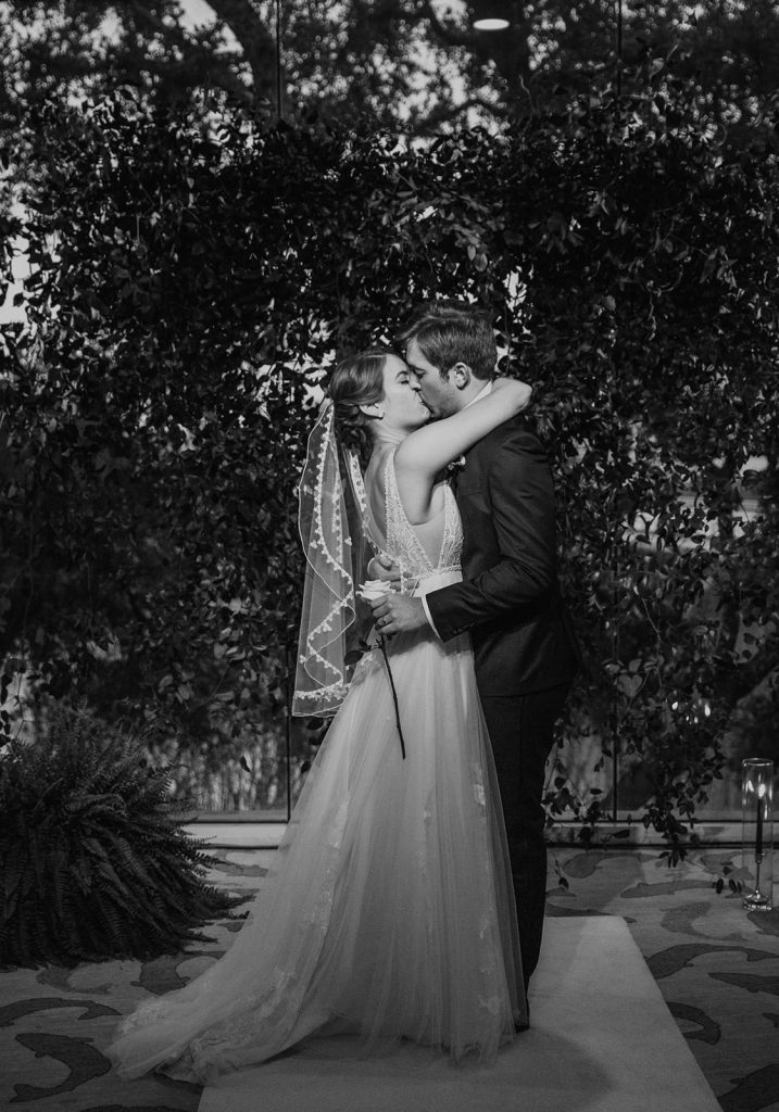 Photo of a bride and groom kissing, photographed by Austin, Texas wedding photographer Nikk Nguyen