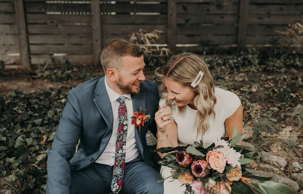 A bride and groom laughing together on their wedding day, photographed by Austin, Texas wedding photographer NIkk Nguyen