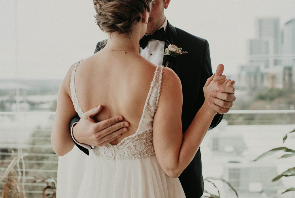 A groom and bride dancing on the roof of the LINE hotel in downtown Austin, Photographed by Austin, Texas wedding photographer NIkk Nguyen