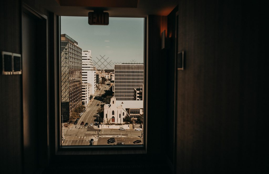 View through a window of the Westin Hotel on downtown Austin, Photographed by Austin, Texas wedding photographer NIkk Nguyen