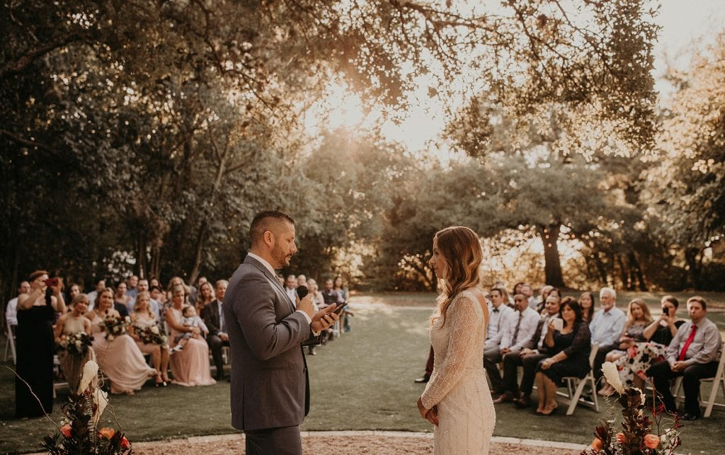 A bride and groom exchange vows during a multilingual wedding ceremony. Photographed by Austin, Texas wedding photographer NIkk Nguyen