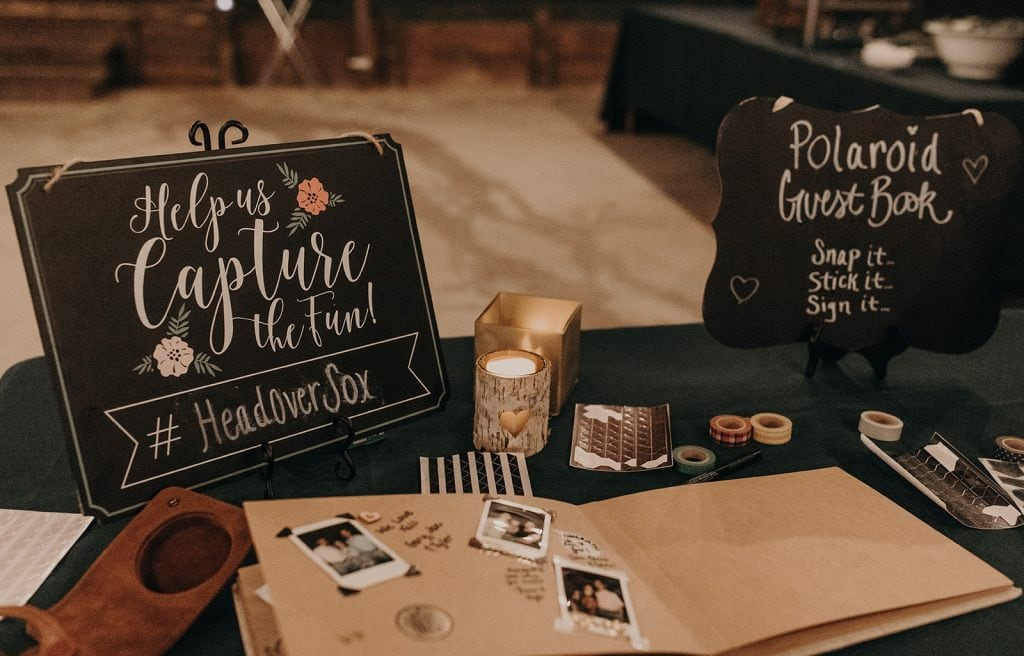Photo booth at wedding reception. Photographed by Austin, Texas wedding photographer Nikk Nguyen.