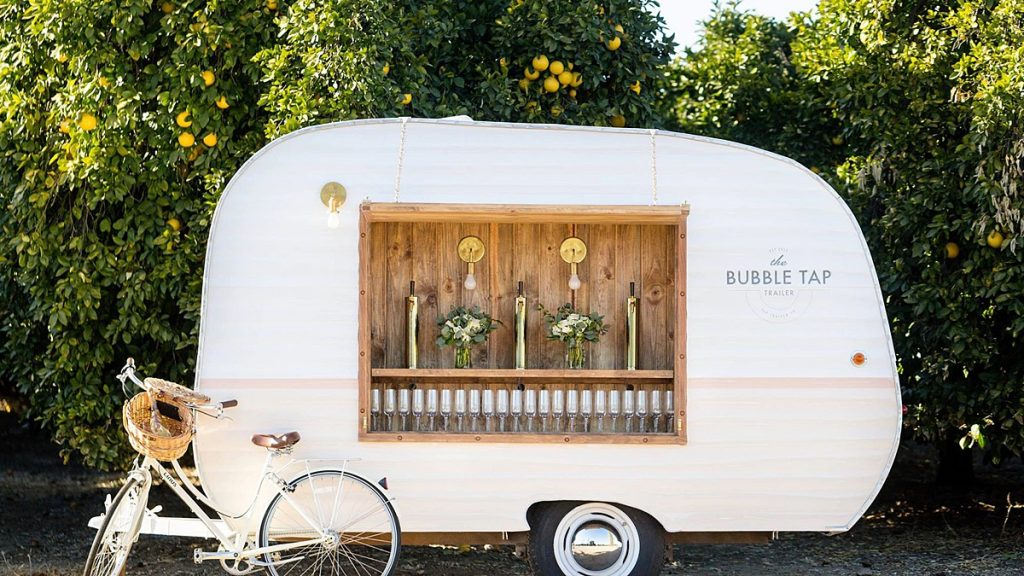 Bubble Tap Trailer with beer taps outside at an event. Blog by Austin, Texas wedding photographer Nikk Nguyen