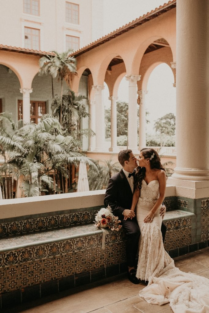 Bride and groom sharing an intimate moment together before reception. Photographed by Austin, Texas wedding photographer Nikk Nguyen