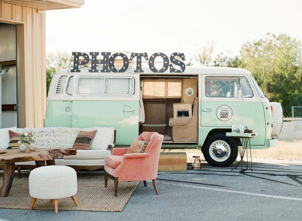 VW van photo booth with pink chair and white couch for wedding guests to take photos in. Blog by Austin, Texas wedding photographer Nikk Nguyen