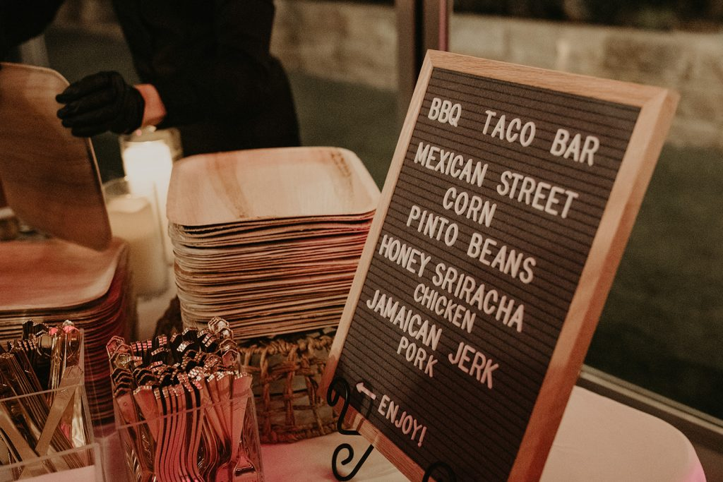 A letter board with the wedding reception menu provided by Catering With a Twist in Austin, Texas. Photography by Austin, TX wedding photographer Nikk Nguyen to promote how to have an epic reception with these Austin, Texas wedding caterers.