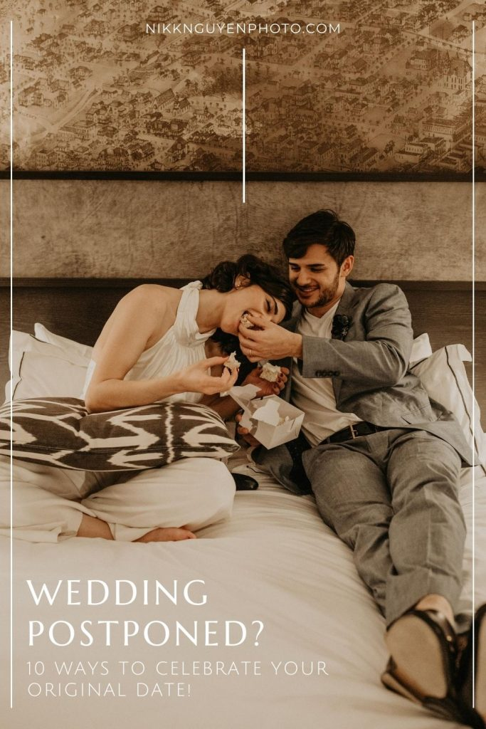 A bride and groom sit on the bed in their hotel room in Austin, TX and groom feeds the bride a piece of cake as they smile. Image overlaid by text that reads Wedding Postponed? 10 Ways to Celebrate Your Original Date, photograph by Austin, Texas wedding photographer Nikk Nguyen.