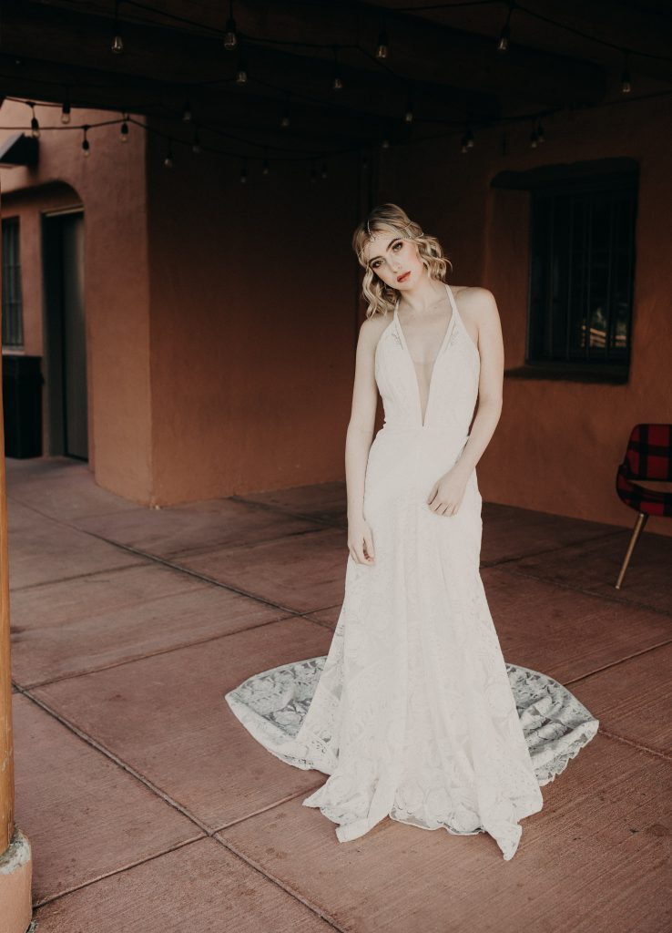 A bride in a vintage wedding gown from A&Bé Bridal Shop in Austin, Texas photographed by Austin, TX wedding photographer Nikk Nguyen.