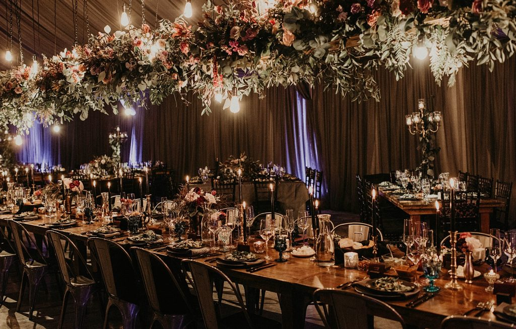 Lush overhanging flowers at a luxurious wedding reception decorated by Flora Fetish, an Austin based floral designer. image by Austin, Texas wedding photographer Nikk Nguyen.