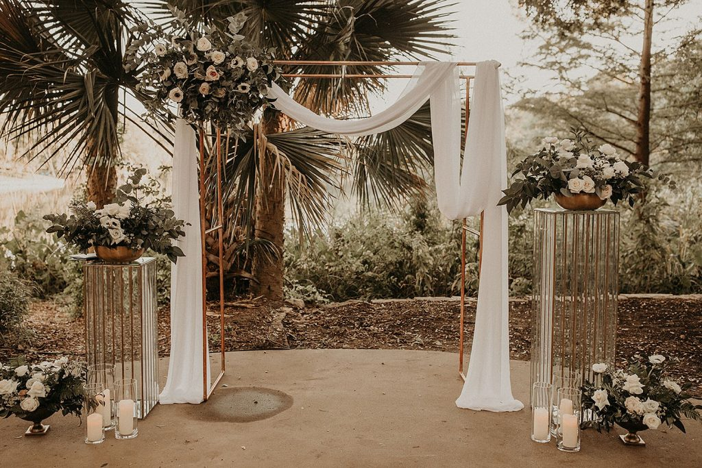 Image of a modern altar decorated with flowers and arrangements from Wildly Cultivated Floral Design, an Austin based floral designer. Image by Austin, TX wedding photographer Nikk Nguyen.