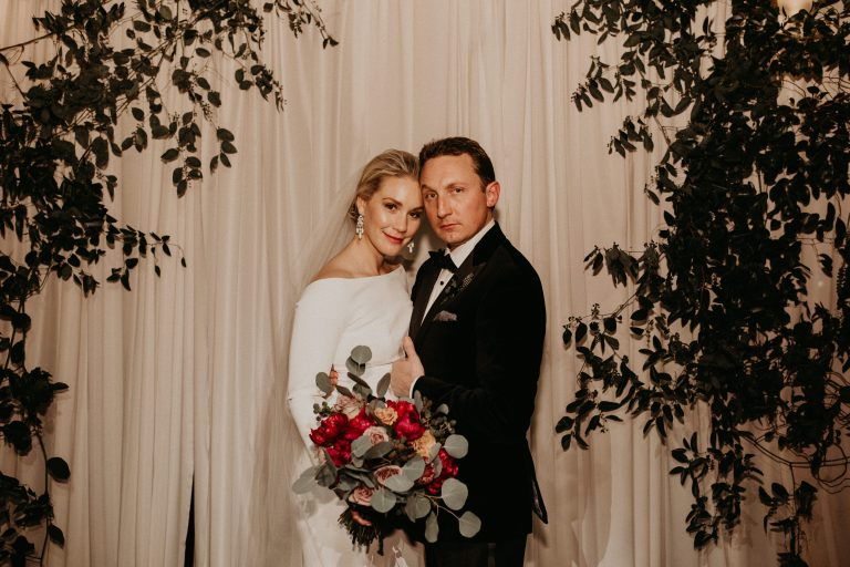 Bride and groom embrace for a portrait during their wedding at Eberly in Austin, Texas. Photography by Austin, TX wedding photographer Nikk Nguyen.