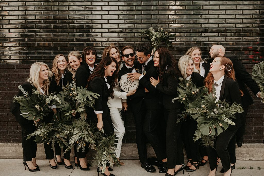 A laughing wedding party of a wedding planned by Burlap & Rose, one of the Austin Texas wedding planners. Image by Nikk Nguyen Photo, an Austin, TX wedding photographer.