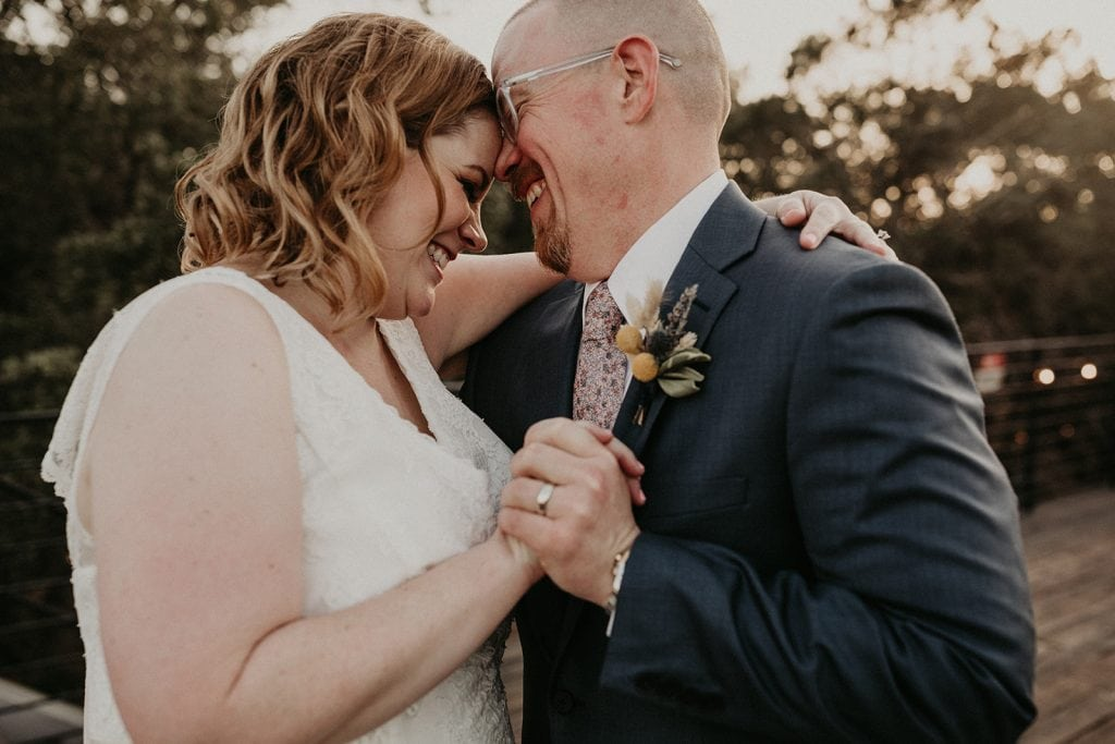 A bride and groom embrace during their first dance during their Lucky Arrow Retreat Elopement photographed by Austin, Texas wedding photographer Nikk Nguyen in Dripping Springs, Texas.