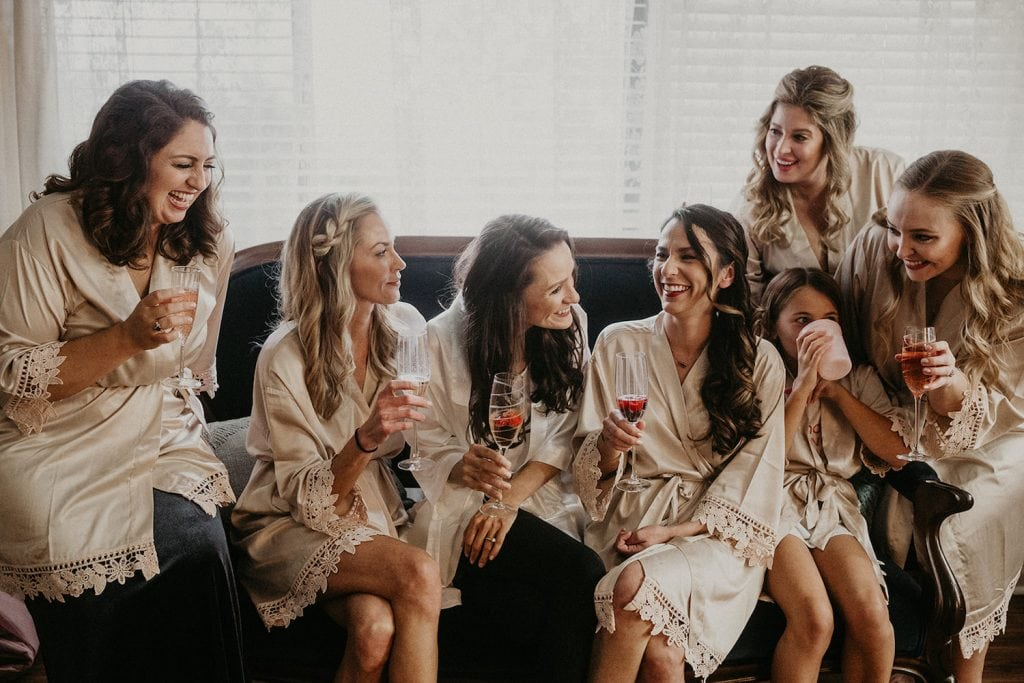 An image of a bride smiling with her bridal party during her bachelorette party in Austin, Texas. Image by Austin, TX wedding photographer Nikk Nguyen.