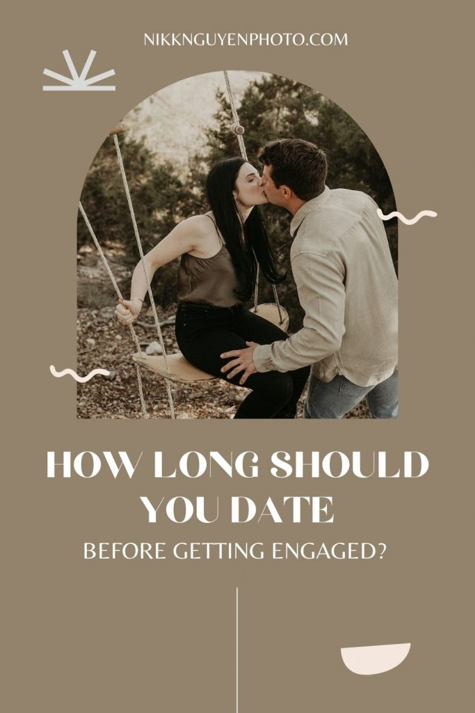 A woman sits on a swing as her boyfriend kisses her; image by Nikk Nguyen Photo and overlaid with text that reads How Long should you date before getting engaged?